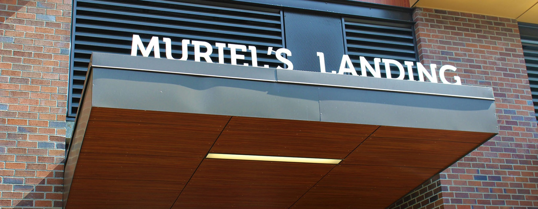 Leasing office entrance with a sign that says Muriel's Landing